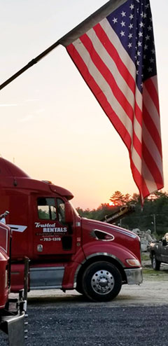 Trusted Rentals truck with American Flag