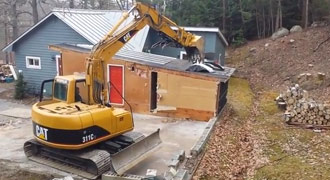 tearing down a shed with a CAT 311